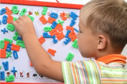 Boy with Autism playing with letters